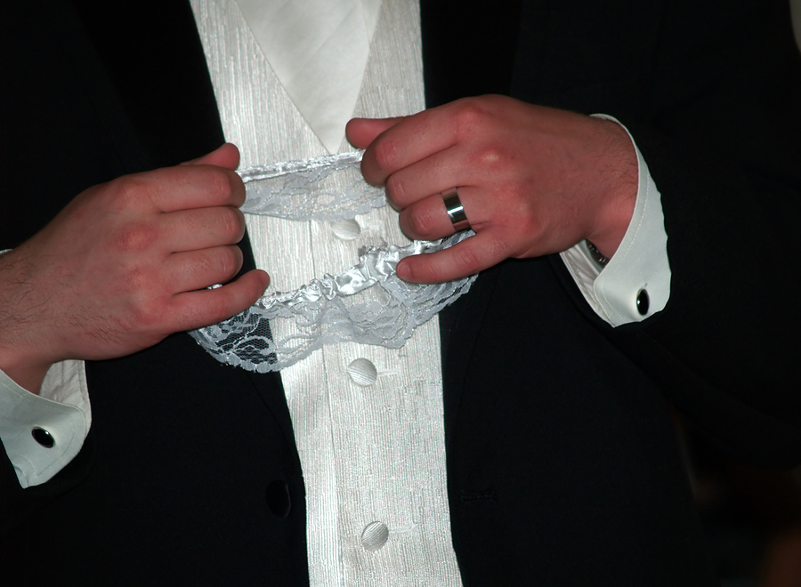 Don't just remove the garter, make a spectacle out of the removal