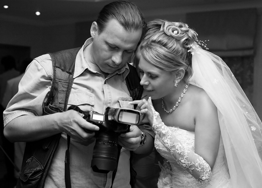 bigstockphoto_Bride_And_Photographer_2869826