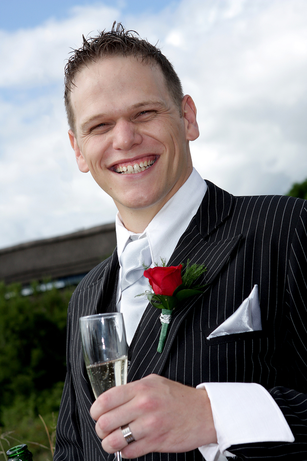 bigstockphoto_Groom_Toast_3137357