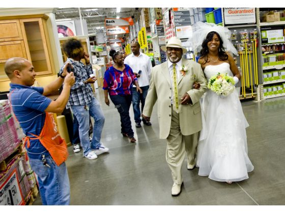 "This bride and groom chose to walk down the ""aisle"" at Home Depot."