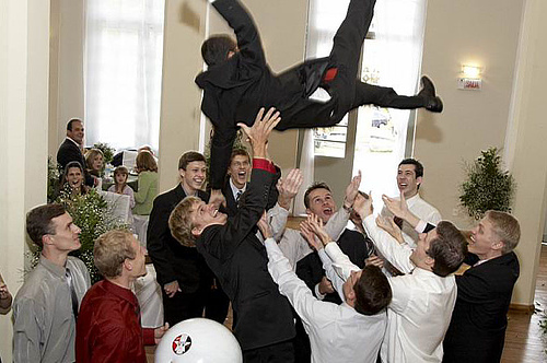 tossing-groom-in-air