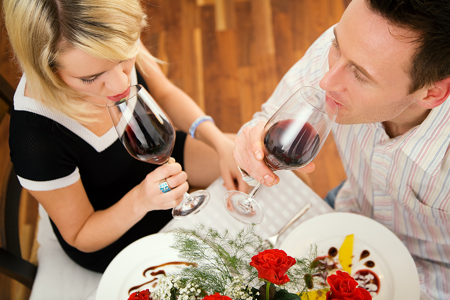 couple drinking red wine on valentine's day