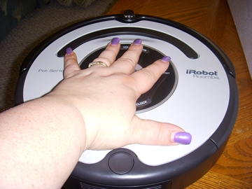 woman touching roomba