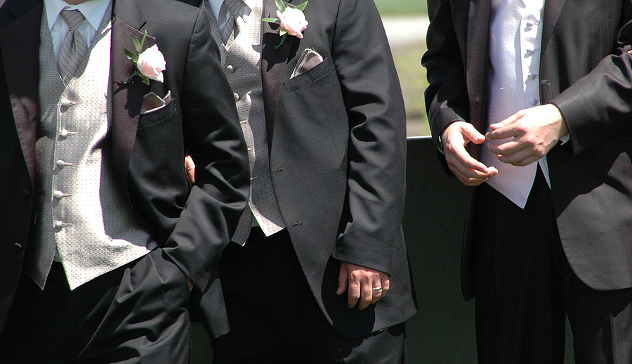 double breasted tux while the groomsmen wear two or threepiece suits