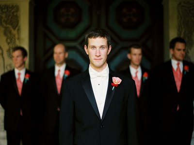 groom in front of groomsmen