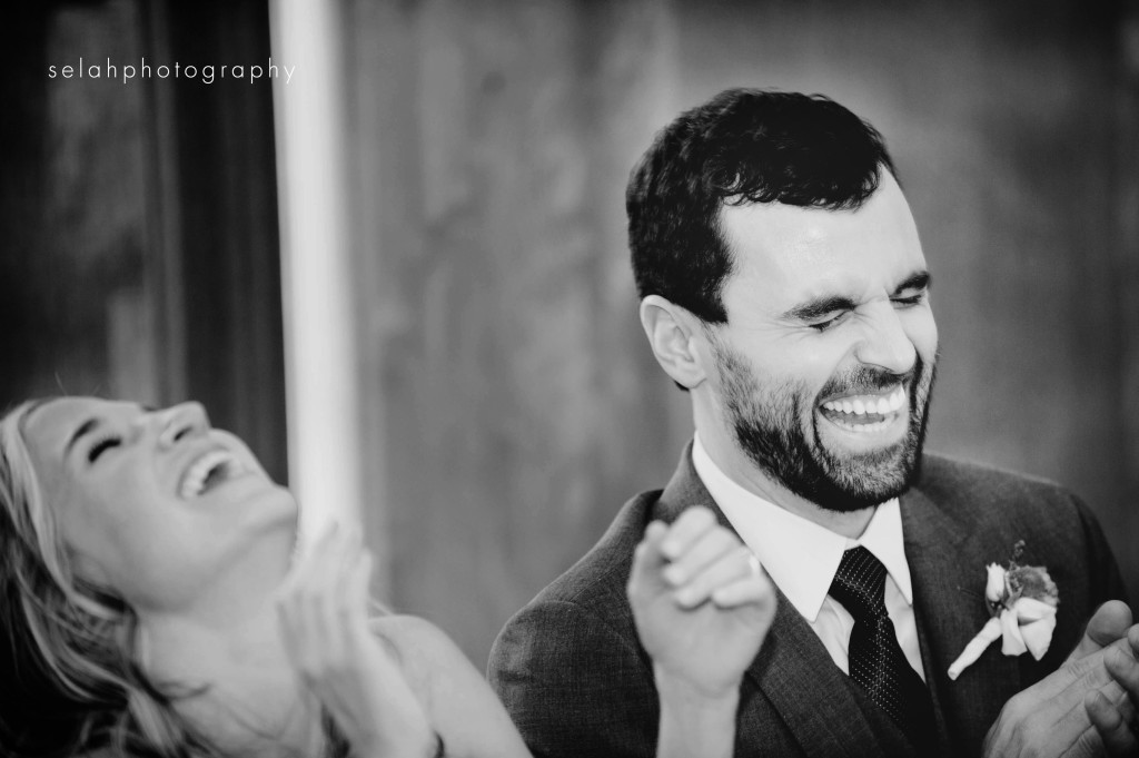 bride and groom laughing during the best man toast
