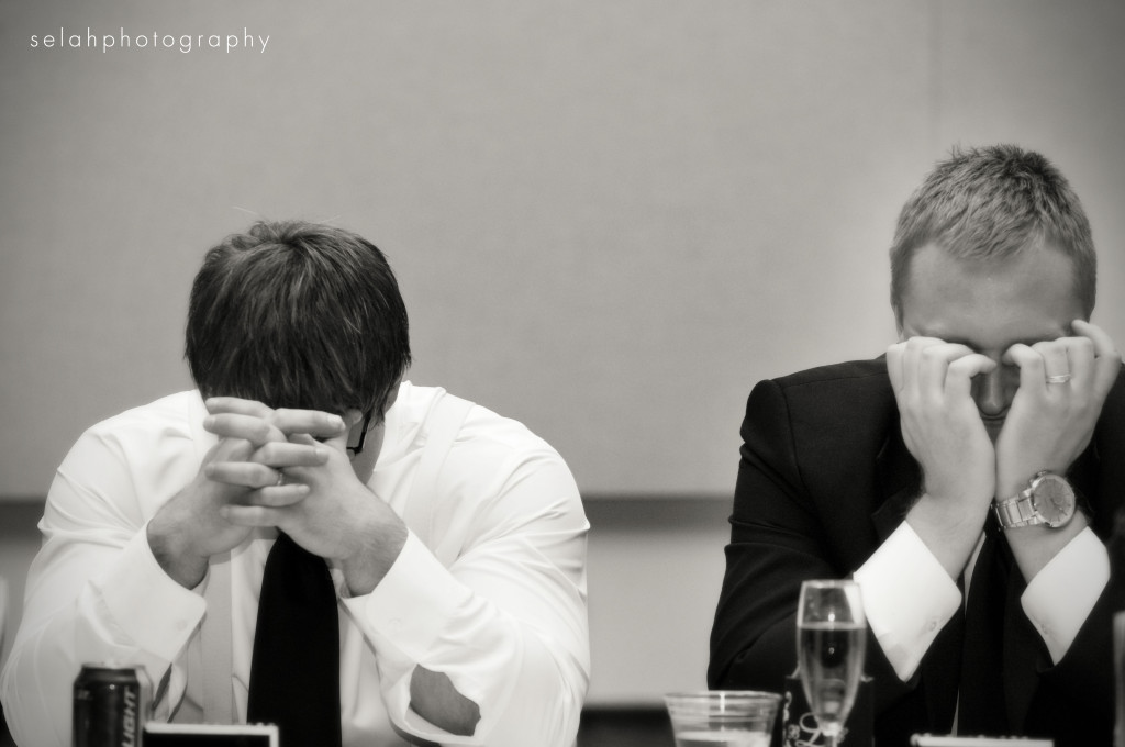 groom bows his head during best man speech