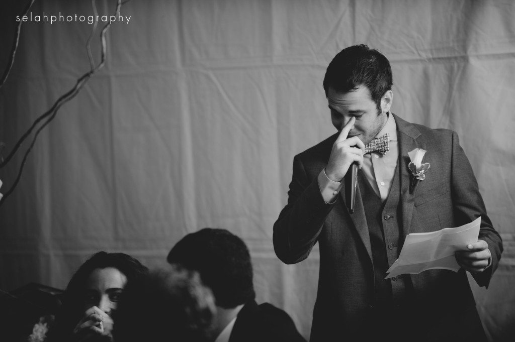 best man cries as he gives wedding toast in black and white