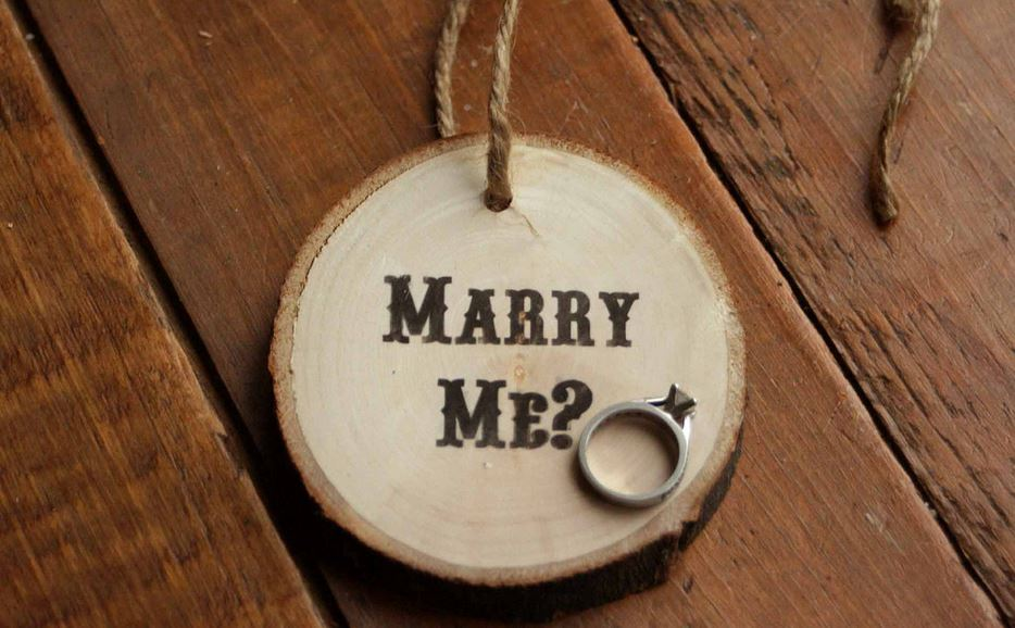 A beautiful handmade Christmas tree ornament that asks if she'll marry you.