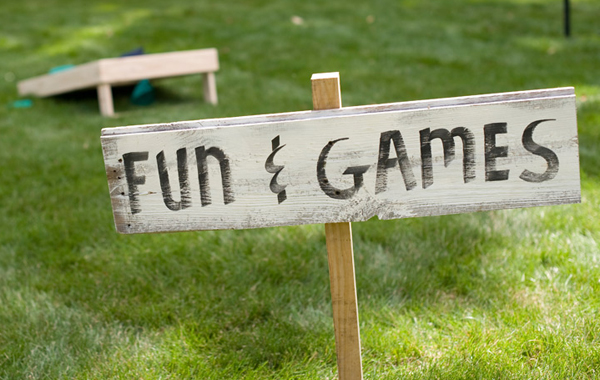 a handmade sign for the lawn games area of your backyard