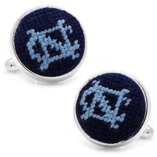 Perfect for adding subtle team spirit to dressy looks, these stylish, hand-stitched needlepoint cufflinks are set in a silver-plated setting and feature a bullet back closure.
