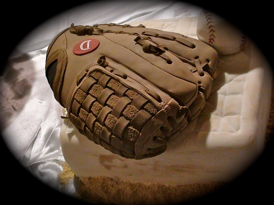This baseball glove groom's cake showcases amazingly realistic detail.