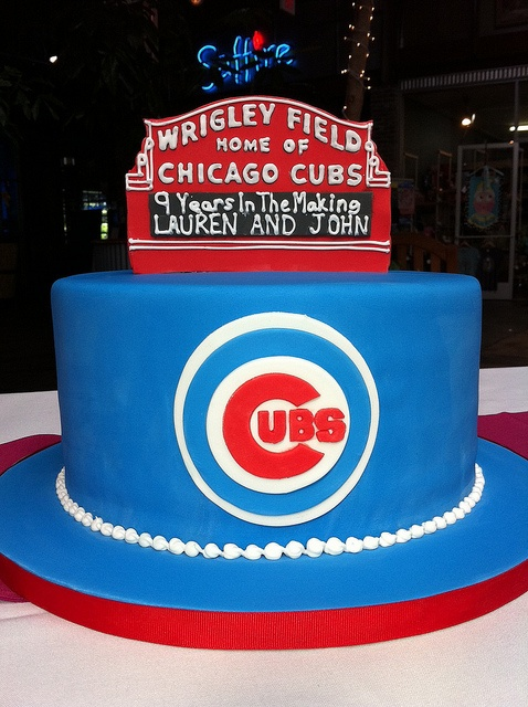 This Chicago Cubs groom's cake highlights the groom's favorite team and how long the couple's been dating.